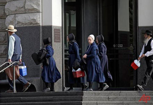 Group of Amish leave the U.S. courthouse in Cleveland Wednesday, Sept ...