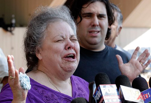 Step Mother Marcia Savio, half brother Nicholas Savio Photo / AP - M. Spencer Green