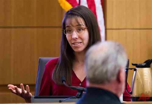 Jodi Arias demonstrates how she says Travis Alexander lunged at her ...
