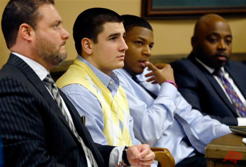 From left, Defense attorney Adam Nemann, his client, defendant Trent Mays, 17, and co-defendant 16-year-old Ma'lik Richmond listen to testimony during Mays and Richmond's trial on rape charges in juvenile court on Thursday, March 14, 2013 in Steubenville, Ohio. Photo / AP Keith Srakocic,Pool