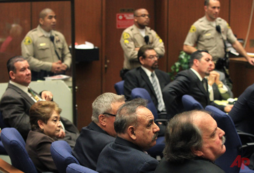 Five former Bell City elected officials listens to the judge as a guilty verdict is read in their trial on Wednesday, March 20, 2013, in Los Angeles. Photo / AP Los Angeles Times - Irfan Khan,Pool