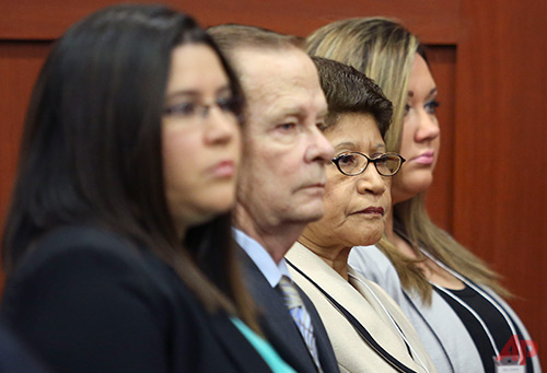 Gracie Zimmerman, left, sister of George Zimmerman, his father, Robert Zimmerman Sr., second from left, his mother, Gladys, second from right, and wife Shellie Zimmerman, right, sit in Seminole circuit court during George Zimmerman's trial in Sanford, Fla.,June 20, Photo / AP - Orlando Sentinel, Gary Green, Pool