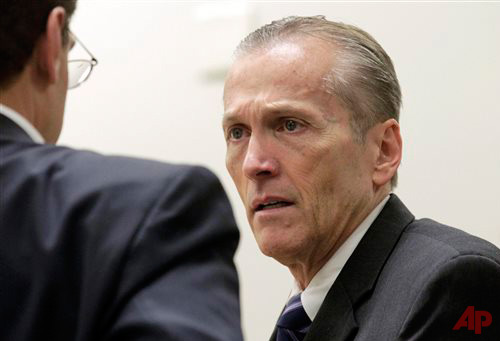 In this Nov. 1, 2013 file photo, Pleasant Grove physician Martin MacNeill speaks with his defense lawyer Randy Spencer, during his murder trial in Provo, Utah. Photo / AP - The Salt Lake Tribune Al Hartmann, Pool -File
