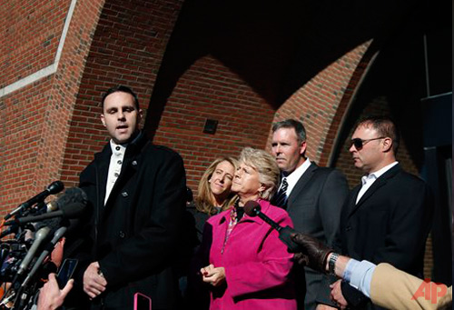 Tommy Donahue, son of Michael Donahue, speaks to the media as his fiancee Michelle Carter, his mother Patricia Donahue, and his brothers Shawn and Michael Jr. (far right) listen outside federal court in Boston Nov. 14,2013.  Photo / AP -Elise Amendola