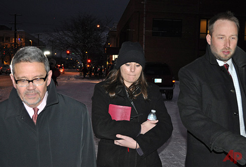 In this Tuesday, Dec. 10, 2013 photo, Jordan Graham, center, is flanked by defense attorneys Michael Donahoe, left, and Andy Nelson, as she leaves court in Missoula, Mont. Photo / AP - Stephan Ferry