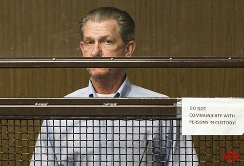 Facing charges: Lance Anderson (right) speaks to Public Defender Victor Gerson after being charged with murder for the deaths of his sister and wife Photo / AP