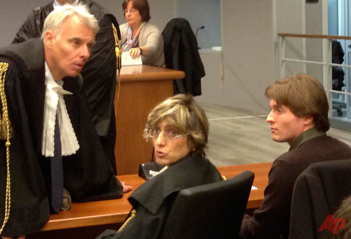 In this Wednesday, Nov. 6, 2013 file photo taken with a mobile phone, former American exchange student Amanda Knox's Italian ex-boyfriend Raffaele Sollecito, right, sits with his lawyer Giulia Bongiorno, center, as Knox's lawyer Carlo Dalla Vedova speaks to them ahead of a hearing in Sollecito and Knox's trial at an appeals court in Florence, Italy. Photo / AP - Patricia Thomas File