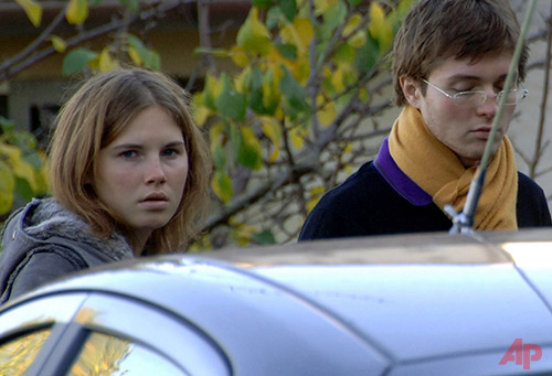In this Friday, Nov. 2, 2007 file photo, Amanda Knox, left, and Raffaele Sollecito, are seen outside the rented house where 21-year-old British student Meredith Kercher was found dead in Perugia, Italy. Defense lawyers for U.S. student Amanda Knox and her Italian former boyfriend will get their final say on Monday, Jan. 20, 2014 in the defendants' third trial for the gruesome 2007 murder of Knox's British roommate. (AP Photo/Stefano Medici, File)
