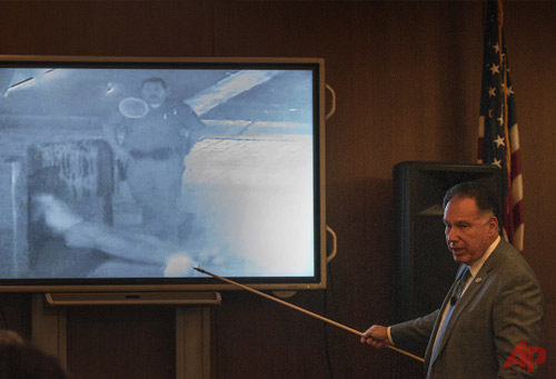 Orange County District Attorney Tony Rackauckas shows the jury an image of former Fullerton police officer Manuel Ramos and Kelly Thomas at the Fullerton Transportation Center on July 5, 2011 during the trial of former Fullerton officers Ramos and Jay Cicinelli on Monday, Dec. 2, 2013 in Santa Ana, Calif.