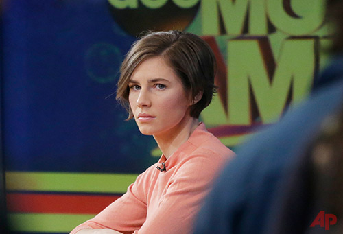 "Amanda Knox waits on a television set for an interview, Friday, Jan. 31, 2014 in New York. Knox said she will fight the reinstated guilty verdict against her and an ex-boyfriend in the 2007 slaying of a British roommate in Italy and vowed to ""never go willingly"" to face her fate in that country's judicial system . ""I'm going to fight this to the very end,"" she said in an interview with Robin Roberts on ABC's ""Good Morning America."" (AP Photo/Mark Lennihan)"