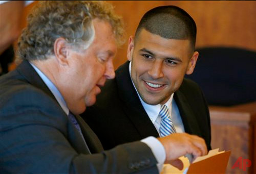 Former New England Patriots football player Aaron Hernandez, right, smiles at his lawyer Michael Fee during a hearing in Bristol County Superior Court in Fall River, Mass., Wednesday, July 9, 2014. (AP Photo/Dominick Reuter, Pool)