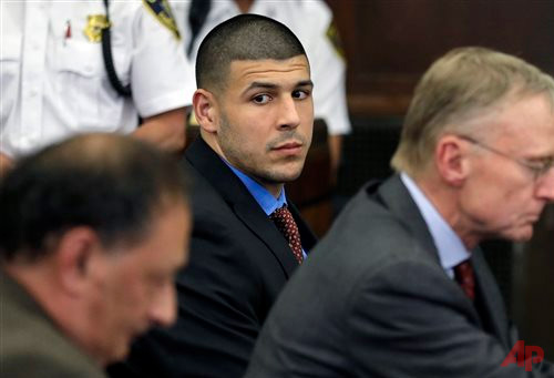 n this Tuesday, June 24, 2014, file photo, former New England Patriots football player Aaron Hernandez, center, looks toward defense attorneys James Sultan, left, and Charlie Rankin, right, during a hearing in Suffolk Superior Court in Boston. Hernandez is charged in the 2012 shooting deaths of Daniel de Abreu and Safiro Furtado after an encounter at a Boston nightclub. Hernandez is expected to be in court Wednesday, July 2, 2014, for a hearing in wrongful death civil lawsuits filed against him by the two men's families. (AP Photo/Steven Senne, Pool, File)