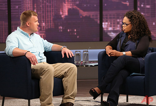 This June 27, 2014 image released by OWN shows Matt Sandusky, the adopted son of former Penn State University assistant football coach Jerry Sandusky, during an interview with Oprah Winfrey, airing on OWN on Thursday, July 17. Matt Sandusky says he enjoyed spending time with the family at their central Pennsylvania home _ except when it came time to go to bed. The Oprah Winfrey Network on Wednesday, July 16, released a clip of Winfrey's interview with Matt Sandusky, who alleges he was sexually abused by his father. (AP Photo/Harpo, Inc., George Burns)