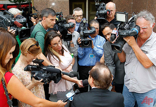 Max Blecher, attorney for Los Angeles Clippers owner Donald Sterling, talks to reporters during a break in the Clippers-Sterling trial in Los Angeles, Monday, July 28, 2014. Closing arguments are underway in the trial to determine whether the estranged wife of Donald Sterling can sell the Los Angeles Clippers to former Microsoft CEO Steve Ballmer for $2 billion. The arguments Monday follow days of testimony involving Shelly Sterling's removal of her husband from the family trust that owns the team after doctors found him to be mentally incapacitated. Blecher has argued that the removal was the result of a conspiracy between Shelly Sterling and NBA Commissioner Adam Silver. (AP Photo/Nick Ut)