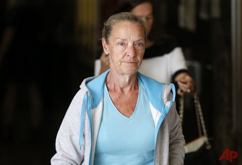 Julie Patz, mother of Etan Patz, leaves a courtroom in New York, Monday, Sept. 15, 2014. The videotaped confession of Pedro Hernandez, who admitted killing 6-year-old Etan Patz in 1979, is expected to be played in court as a Manhattan judge determines whether it is fair game for the suspect's murder trial. The hearing that begins Monday is expected to last several weeks to determine whether Pedro Hernandez's statements are admissible in the case. (AP Photo/Seth Wenig)