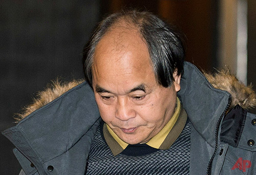 Diran Lin, father of Jun Lin, walks at the Montreal Courthouse on the eighth day of jury deliberations in the murder trial for Luka Magnotta Tuesday, Dec. 23, 2014. A jury found Magnotta guilty on Tuesday of killing and dismembering Jun Lin, his Chinese lover and mailing the body parts to schools and political parties around the country. (AP Photo/The Canadian Press, Graham Hughes)