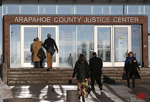 People enter the Arapahoe County Justice Center in Centennial, Colo., Tuesday, Jan. 20, 2015. The jury selection process in the trial of Aurora theater shooting suspect James Holmes began Tuesday, and is expected to take several weeks to a few months. Holmes is charged with killing 12 people and wounding more than 50 in an Aurora movie theater in 2013. (AP Photo/Brennan Linsley)
