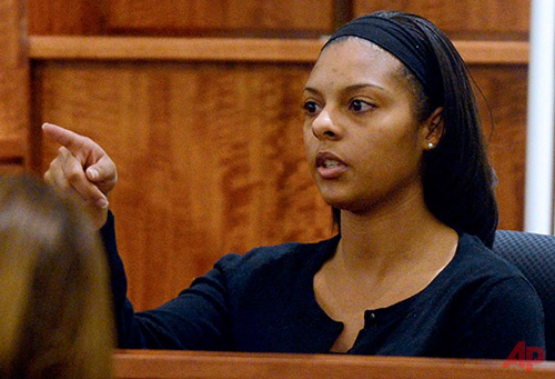 Shaneah Jenkins, who was dating Odin Lloyd, points to former New England Patriots football player Aaron Hernandez when asked by a prosecutor to identify him in the courtroom during Hernandez's murder trial, Friday, Jan. 30, 2015, in Fall River, Mass. Hernandez is charged with killing semiprofessional football player Odin Lloyd, 27, in June 2013. (AP Photo/The Boston Herald, Ted Fitzgerald, Pool)