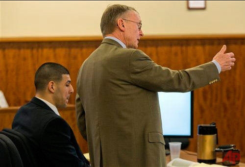Defense attorney Charles Rankin, right, cross-examines a witness during the murder trial for former NFL player Aaron Hernandez, left, at the Bristol County Superior Court in Fall River, Mass., Wednesday, Feb. 18, 2015. Hernandez is accused in the June 17, 2013, killing of Odin Lloyd, who was dating his fiancée's sister. (AP Photo/Dominick Reuter, Pool)