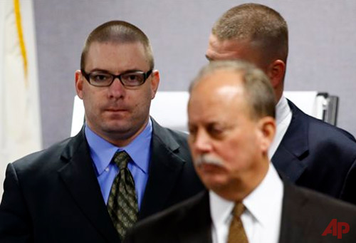 Eddie Ray Routh, left, enters the courtroom with defense attorney J. Warren St. John following a break in his capital murder trial at the Erath County, Donald R. Jones Justice Center in Stephenville, Texas, Wednesday, Feb. 18, 2015. Routh is charged with the 2013 deaths of former Navy SEAL Chris Kyle and his friend Chad Littlefield at a shooting range near Glen Rose, Texas. (AP Photo/Mike Stone, Pool)