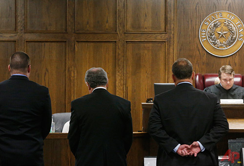State District Judge Jason Cashon, right, reads the sentence of guilty at the capital murder trial of former Marine Cpl. Eddie Ray Routh at the Erath County, Donald R. Jones Justice Center in Stephenville, Texas, on Tuesday, Feb. 24, 2015. Routh, 27, of Lancaster, was convicted of the 2013 deaths of Chris Kyle and his friend Chad Littlefield at a shooting range near Glen Rose, Texas. (AP Photo/The Dallas Morning News, Michael Ainsworth, Pool)