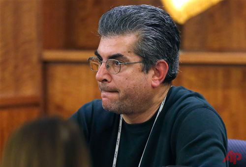 Television cameraman Robert Cusanelli, from Boston station WHDH-TV, testifies under oath while the jury deliberates in the murder trial for former New England Patriots football player Aaron Hernandez, Thursday, April 9, 2015, in Fall River, Mass. Superior Court Judge E. Susan Garsh on Thursday banned Cusanelli from the courthouse after he testified under oath that he had followed jurors to their parking spots a day earlier. Hernandez is charged with killing Odin Lloyd. (AP Photo/Steven Senne, Pool)