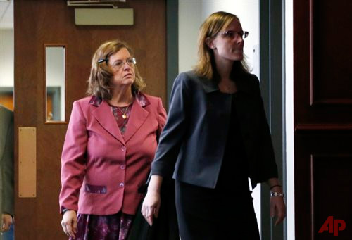 In this Dec. 8, 2014 file photo, Arlene Holmes, left, mother of James Holmes who is charged in the killing of 12 moviegoers and the wounding of 70 others in a shooting spree in a crowded theatre in Aurroa, Colo., on July 20, 2012, leaves the courtroom after a pre-trial readiness hearing in Centennial, Colo., in the murder trial of her son. After more than two months of testimony in the trial, new details have been revealed to show the strained relationship that had developed between Holmes, his parents and sister leading up to the massacre in the theatre. (AP Photo/David Zalubowski, File