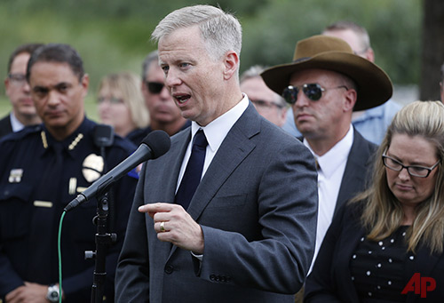 District Attorney George Brauchler speaks with members of the media following the reading of the jury's decision that Colorado theater shooter James Holmes will not receive the death penalty, outside the Arapahoe County District Court in Centennial, Colo., Friday, Aug. 7, 2015. Holmes will be sentenced to life in prison without parole after a jury failed to agree on whether he should get the death penalty. (AP Photo/Brennan Linsley)