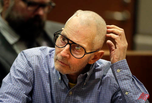 In this Dec. 21, 2016 file photo, real estate heir Robert Durst sits in a courtroom during a hearing in Los Angeles. Before a judge even decides if there's enough evidence to try Durst on an old murder charge, prosecutors plan to start taking testimony. In a rare hearing Tuesday, Feb. 13, two witnesses will be called to the witness stand against Durst in Los Angeles Superior Court to preserve their testimony in case it is needed later.(AP Photo/Jae C. Hong, Pool, File)