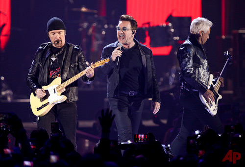 "In this Sept. 23, 2016, file photo, The Edge, from left, Bono and Adam Clayton of the music group U2 perform at the 2016 iHeartRadio Music Festival - Day 1 in Las Vegas. In a lawsuit filed Monday, Feb. 27, 2017, in Manhattan federal court, Paul Rose says U2 lifted elements of his song ""Nae Slappin"" for their song ""The Fly"" while they were looking for new inspiration. (Photo by John Salangsang/Invision/AP, File)"