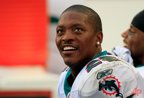 In this Nov. 20, 2011, file photo, Miami Dolphins cornerback Will Allen looks up during the second half of the team's NFL football game against the Buffalo Bills in Miami Gardens, Fla. Former NFL cornerback Allen and his business partner have been sentenced to prison for running a Ponzi scheme that took in more than $35 million. A federal judge in Boston on Wednesday, March 1, 2017, sentenced Allen, of Davie, Fla., and Susan Daub, of Coral Spring, Fla., each to six years in prison and three years of supervised release. They were also ordered to pay restitution totaling $17 million. (AP Photo/Wilfredo Lee, File)
