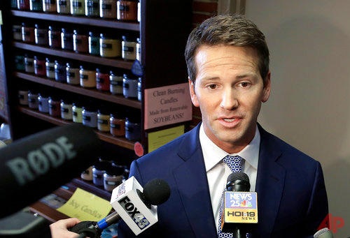 In this Feb. 6, 2015, file photo, former Rep. Aaron Schock, R-Ill. speaks to reporters in Peoria, Ill. Attorneys for former Schock say a staffer secretly provided the government with a trove of confidential documents in violation of his right against unreasonable search and seizure. The lawyers write in March 28, 2017, court filings that the government went too far when it made the staffer an informant, requiring him to wear a wire to record conversations.(AP Photo/Seth Perlman, File)