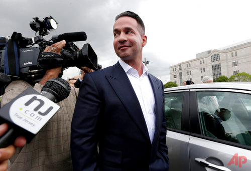 "n this Sept. 24, 2014, file photo, reporters gather around Michael ""The Situation"" Sorrentino as he leaves the MLK Jr. Federal Courthouse in Newark, N.J., after a court appearance. Michael Sorrentino and his brother Marc Sorrentino are set to appear in court to face additional tax fraud charges are scheduled to be arraigned on Monday, April 17, 2017, in federal court in Newark. They previously pleaded not guilty to charges they filed bogus tax returns on nearly $9 million and claimed millions in personal expenses as business expenses. (AP Photo/Julio Cortez, File)"