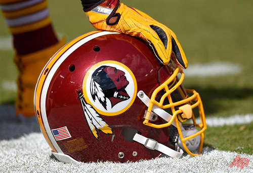 In this Sept. 18, 2016 file photo, a Washington Redskins helmet is seen on the sidelines during the first half of an NFL football game against the Dallas Cowboys in Landover, Md. The Supreme Court on Monday, June 19, 2017, struck down part of a law that bans offensive trademarks in a ruling that is expected to help the Washington Redskins in their legal fight over the team name. (AP Photo/Nick Wass, File)