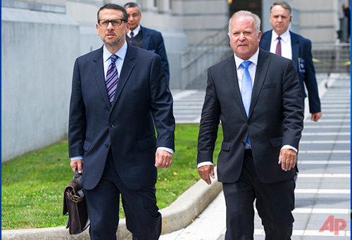In this Wednesday, July 12, 2017 file photo, David Wildstein, left, walks with his attorney Alan Zegas from a federal court in Newark, N.J., after he was sentenced. Nearly 40 years after serving as the statistician on the high school baseball team where Gov. Chris Christie was the catcher, Wildstein's punishment may include running a nonprofit foundation for a former Major League player. Wildstein avoided jail this week while being sentenced for being the mastermind of the George Washington bridge lane-closing scheme. (AP Photo/Craig Ruttle, File)