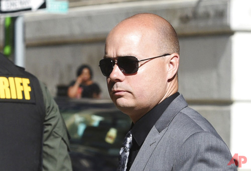 In a Tuesday, July 5, 2016 file photo, Baltimore Police Lt. Brian Rice arrives at Courthouse East, in Baltimore for a pretrial hearing related to the arrest and death of Freddie Gray. Rice, the highest-ranking officer involved in the arrest of Gray, is appearing before a police disciplinary board in Baltimore on Monday, Nov. 13, 2017. (Jerry Jackson/Baltimore Sun via AP, File)
